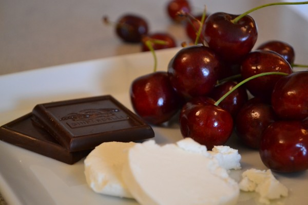 Celebrating Summer! Fresh organic cherries, creamy tangy goat cheese, dark chocolate.